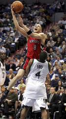 Raptors guard Parker shoots over Timberwolves guard Foye during the second half of their NBA basketball game in Minneapolis