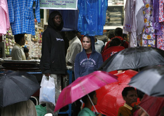 Maranatha International volunteers from the U.S. stand outside a shop during a work break on the main street of Jeypore