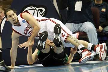 Washington State Low collides with Notre Dame McAlarney during their NCAA men's basketball tournament game in Denver