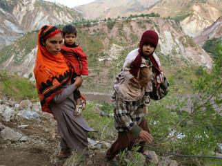 A Kashmiri family walks to cross Neelum Valley, north of Muzaffarabad, capital of Pakistan-administered Kashmir