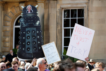 A supporter of Jeremy Corbyn, the leader of Britain's opposition Labour Party, holds up a Doctor Who Dalek cardboard cut out featuring a picture of Prime Minister Theresa May at a campaign event in York
