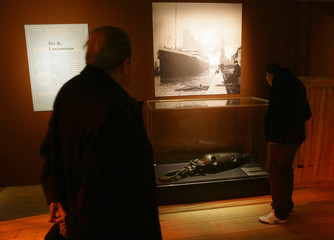 Visitors watch pictures and objects of the Titanic at an exhibition in Madrid