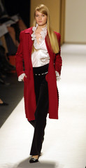 RED COAT FROM THE OSCAR DE LA RENTA FALL 2001 COLLECTION.