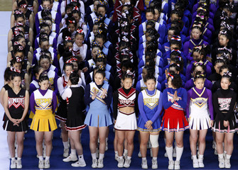 Japanese cheerleading team Buffalos react as they win third place during an award ceremony at the Cheerleading Asia International Open Championships in Tokyo