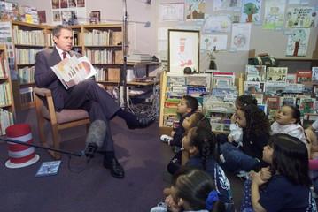 BUSH READS TO CHILDREN AT CHARTER SCHOOL.