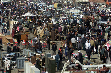 IRAQIS SELL GOODS AT OPEN MARKET IN BAGHDAD.