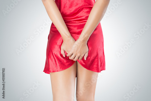 Woman has Farting Holding his bum isolated on White