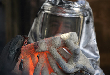 "Foundryman carries a mold as it is prepared for the pouring of ""The Actor"" statuettes in Burbank"
