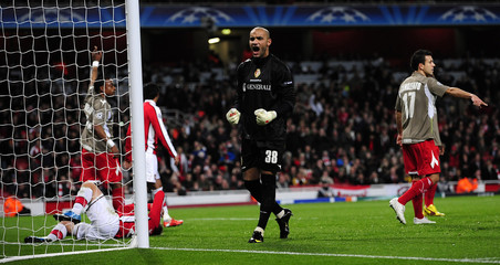 Standard Liege's goalkeeper Bolat reacts after saving a shot from Arsenal's Gallas during their Champions League soccer match at the Emirates stadium in London