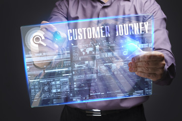Business, Technology, Internet and network concept. Young businessman working on a virtual screen of the future and sees the inscription: Customer journey