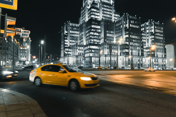 Fototapeta Cars in motion on the road in night city