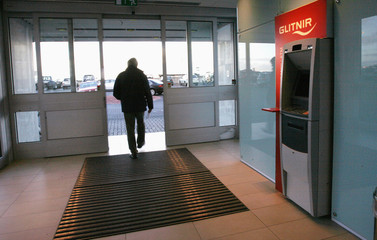 A man walks out of the building of Iceland's Glitnir Bank's headquarters in Reykjavik