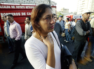A VENEZUELAN WOMAN CRIES IN FRONT BLAST AREA AT COLOMBIA`S CONSULATE.