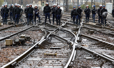 Riot police face students occupying Gare du Lyon station in Paris during protest against CPE youth jobs law