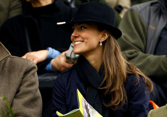 Middleton smiles as she watches the first race at the Cheltenham Festival horse racing meeting