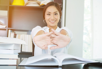 Businesswoman stretching arm on work table