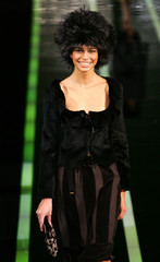A model presents a creation as part of Emporio Armani's Fall/Winter 2006-2007 women's collection in Milan.