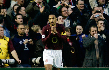 Arsenal's Henry reacts after a goal is disallowed during Champions League match in London