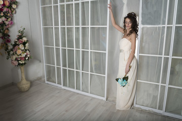 Girl in a white dress at the door.
