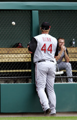 Reds' Adam Dunn can only watch as Cardinals' Hector Luna hits solo home run into Red's bull pen during game in St. Louis
