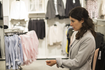 Woman buying clotes in mall