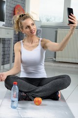 sporty fit fitness woman making selfie at home