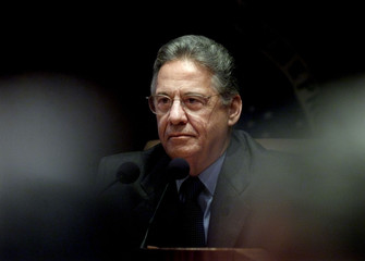 A somber President Fernando Henrique Cardoso presides over an emergency meeting of Cabinet ministers..
