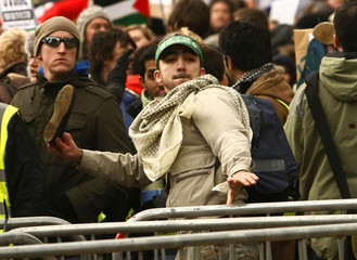 A protestor throws a shoe outside the United States consulate during a demonstration in Edinburgh, Scotland