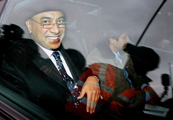 Mittal head of Mittal Steel and his son arrive at Belgian Prime Minister Verhofstadt's office in Brussels