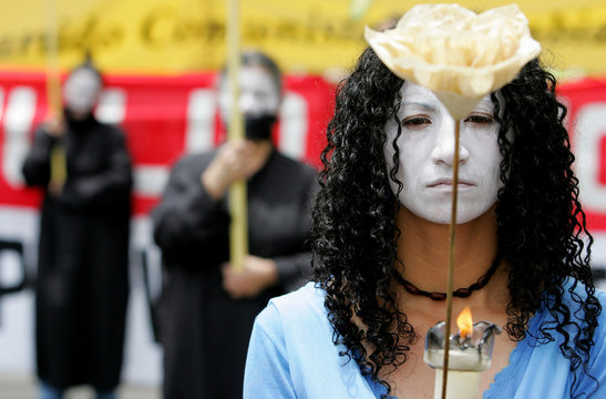 A Colombian woman hold a flower during May Day in Bogota.