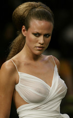 MODEL PRESENTS VIRZI SPRING SUMMER COLLECTION AT RIO FASHION WEEK SHOW.