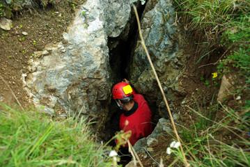 Caver descends in a cave