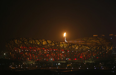 The Olympic cauldron is lit at the National Stadium during the opening ceremony of the Beijing 2008 Olympic Games