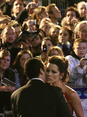 "British actress Beckinsale kisses U.S. actor Sandler as they arrive for the premiere of their new film ""Click"" in Leicester Square"