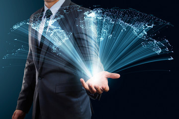 businessman holding abstract glow line and world map concept of global connection