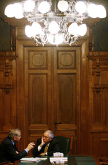 Councillor of state Wicki talks to Swiss Minister of Justice Blocher before the  parliament's state council spring session in Bern