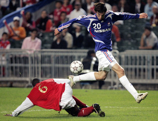 Mike Havenaar of Japan's Yokohama F. Marinos fights for the ball against Cristiano Alves Pereira of Hong Kong's South China during a friendly football match in Hong Kong
