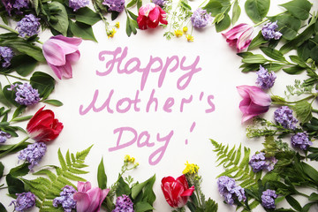 Message with Mother's Day with tulips and with lilacs