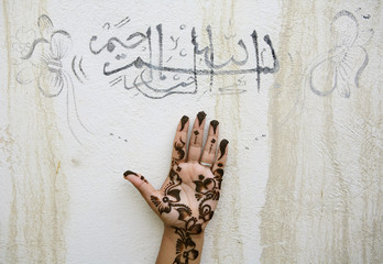 Iranian woman holds up her hand in Qeshm Island southeast of Tehran