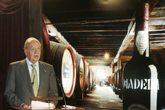 Spanish King Juan  talks to audience during visit to wine institute on Atlantic island of Madeira