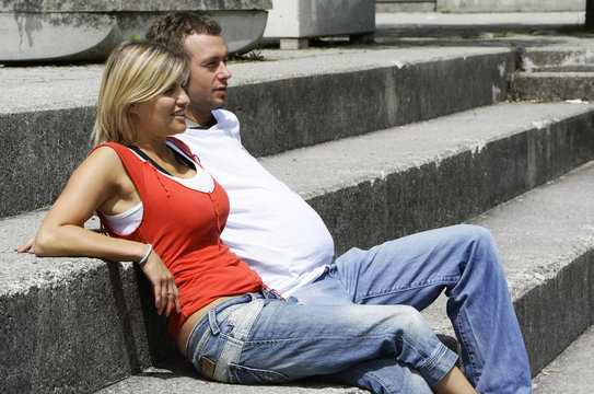 A couple poses with the wearable beer belly (Bierbauch) for men and the wearable wine bra (Getraenke-BH) for women in Ismaning