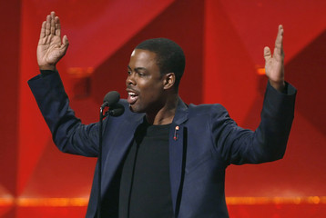 Comedian Chris Rock introduces the Red Hot Chilli Peppers at the 49th Annual Grammy Awards in Los Angeles