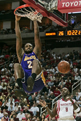Los Angeles Lakers guard Fisher dunks the ball over Houston Rockets guard Jackson in the first half of their NBA game in Houston