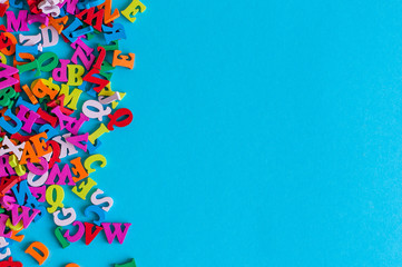 Template with many color letters, ABC with blue background and empty space for text. Business and education concept