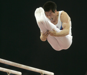 South Korea's Yang Tae Young performs on the parallel bars during Asian Games in Doha