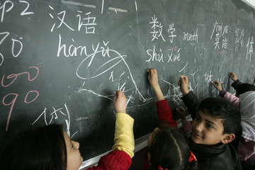Students study Chinese characters at Qunxing international school in Yiwu