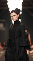 A model presents a creation by Portuguese designer Nuno Baltazar during a Lisbon Fashion Week show M..