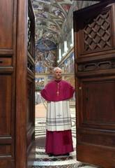 Archbishop Piero Marini closes the doors to the Vatican's Sistine Chapel as cardinals begin ...