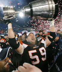 BC Lions Kelly Bates holds up the Grey Cup after win over Montreal Alouettes during the 94th Grey Cup in Winnipeg