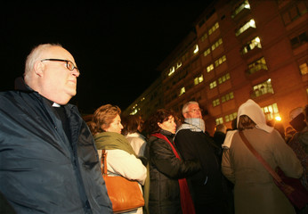 Spanish pilgrims from Andalusia pray for Pope John Paul outside Rome's Gemelli hospital.
